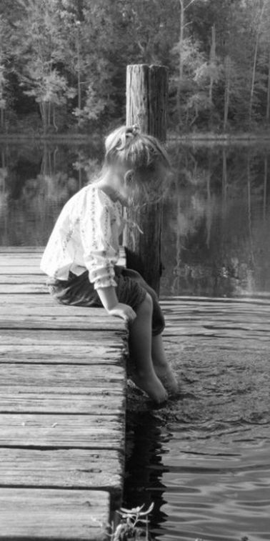 "I stepped outside and saw my little sister sitting on the pier, splashing her bare feet in the murky water of the lake. I screamed, dashing toward her and pulling her away from the water. ""You know you're not supposed to do that!"" I cried, hugging her tightly. ""You know what's in the water."":"