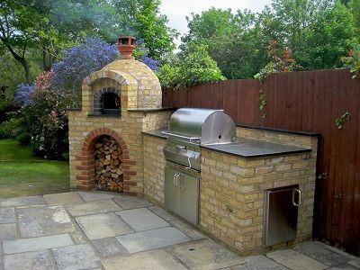 Outdoor Kitchen with charcoal BBQ and wood fired oven