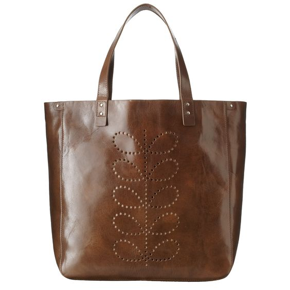 Orla Kiely: Shiny leather bag with punched stem detail and leather handles. Inside details include large stem dark brown cotton lining, small zip, key chain and mobile pocket.        This product is made from high quality Italian leather. This leather will develop a rich patina as it is polished and cherished. Due to the nature and colour of this leather please take care when wearing light clothing as colour may be transferred.
