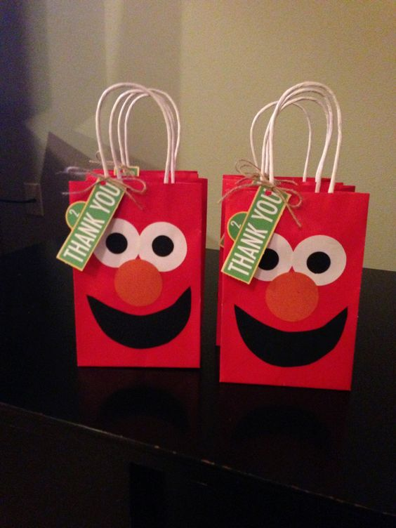 Elmo party favor bags for an Elmo party! I wonder if there would be a way to make a panda face on a white bag???