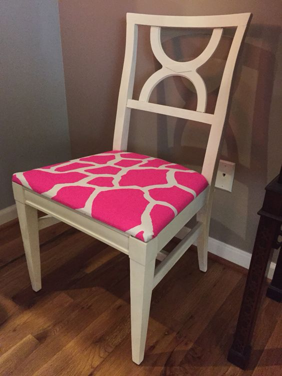 Wooden chair painted with Annie Sloan paint, color old white. Durable canvas seat cushion cover. Farmhouse chic meets modern appointment with this white washed wooden chair cover in pink and white giraffe print.  This is a one of a kind creation by Art E. Bartee Designs. For more, check out Fromtidewater.wordpress.com or like us on Facebook, keyword: Art E. Bartee Designs.    http://fromtidewater.wordpress.com/2014/10/10/salvaged-chairs/  http://atlanta.craigslist.org/atl/fuo/4726481649.html