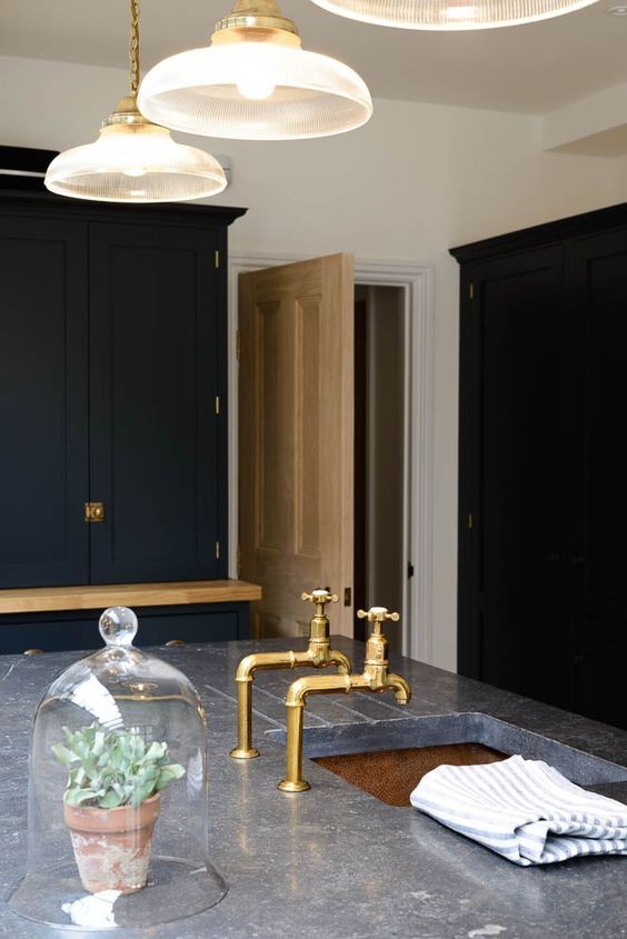 Amazing Belgian Blue Fossil Worktops and Aged Brass taps by deVOL Kitchens