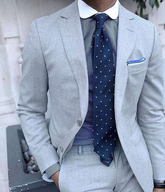 Blue dotted tie with black checks