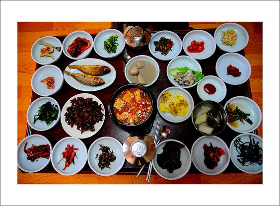 A typical Korean dinner comprised with rice and vegetables and broiled fish