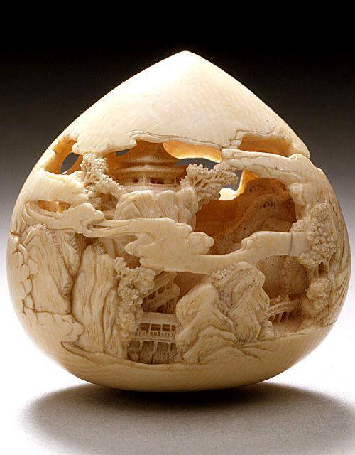 Japanese Netsuke - Buddhist Jewel of Wisdom Carved with Mountain Pavilions by Kaigyokusai (Masatsugu) (Japan, Osaka, 1813-09-13 - 1892-01-21) / Mid to late 19th century , Ivory with staining, sumi, inlays: