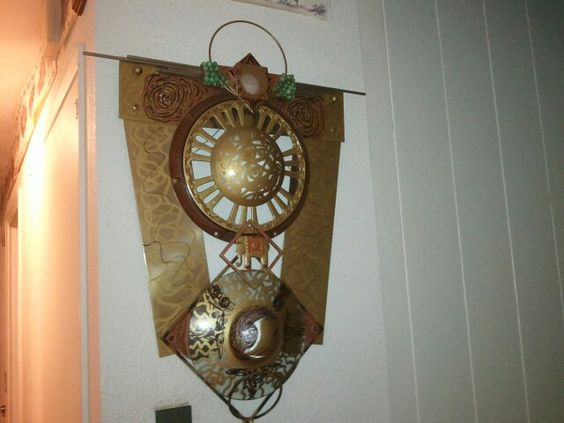 Wall art made from ceiling fan,light glass and scrap metal.