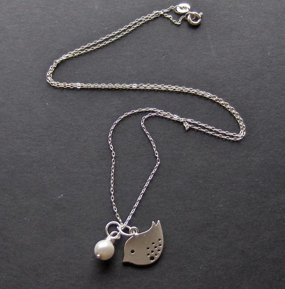 Birdie and pearl charm together! But bird and chain are not the same metal. WHY?!