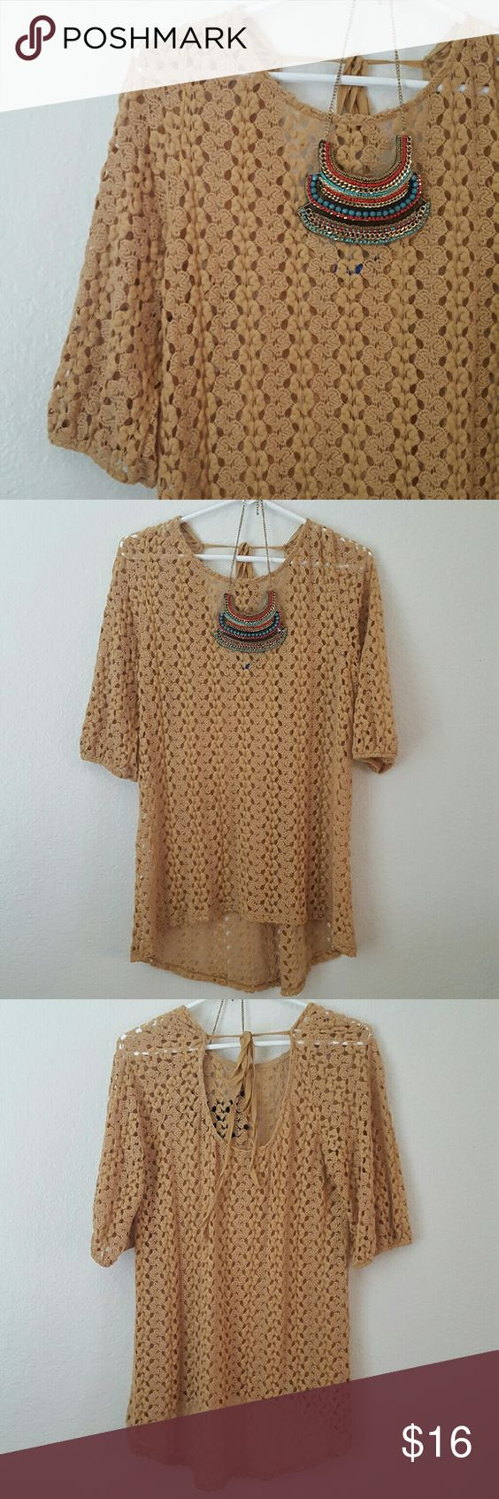 """Knitted mustard boutique top Sweet Claire boutique top. Knitted/crocheted top. Hi lo, 3/4 sleeves and adorable tie back cut out.   No size tag but fits a small to small medium best. Underarm to underarm 18"""" length 26"""" in front 32"""" in back   Excellent condition. Cute with skinnies and booties!  **necklace not for sale** Sweet Claire Tops"""