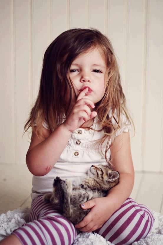 Shhhh…I took this kitty from next door ; )