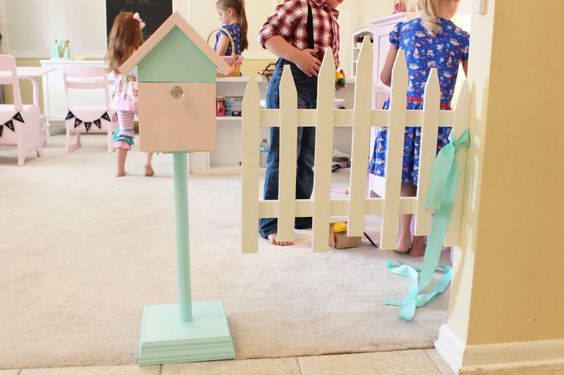Homeschooling - My husband made this out of scrap wood that we had laying around.  The picket fence is actually hung with spring hinges and is used as the door to their play house area.