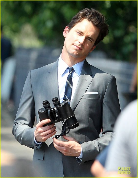 Matt Bomer is dapper in a suit while filming scenes for the sixth and final season of his show White Collar on Monday (July 7), 2014 in New York City.