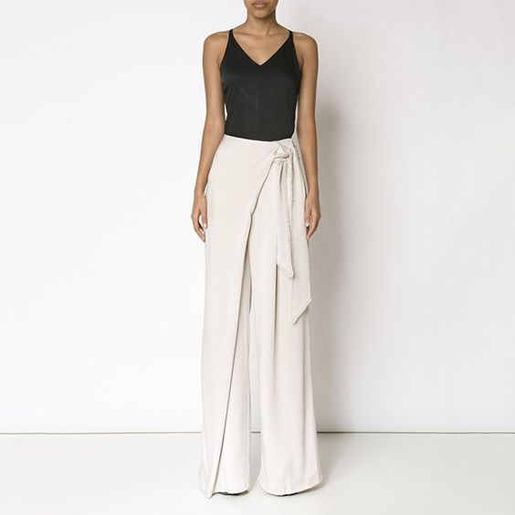 Beige wrap palazzo trousers from Maiyet.
