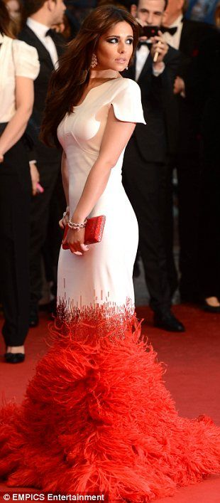 Time to shine: Despite not being the star of the film Cheryl was the one who got the most attention as she arrived