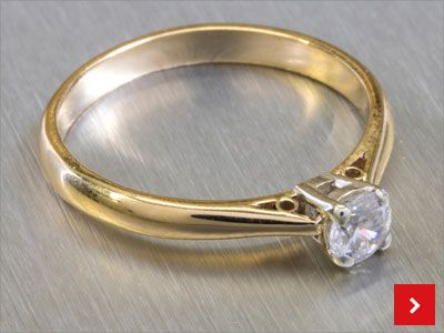 This Simplicity Collet and Shank Ring project allows you to create a simple yet stunning design: http://www.cooksongold.com/downloads/files/simplicity_collet_and_shank_ring.pdf