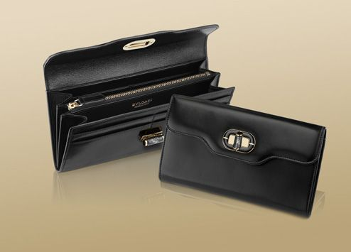 pochette in palmeletto black calf leather with light gold plated hardware and black enamel motif with grey pyrite...