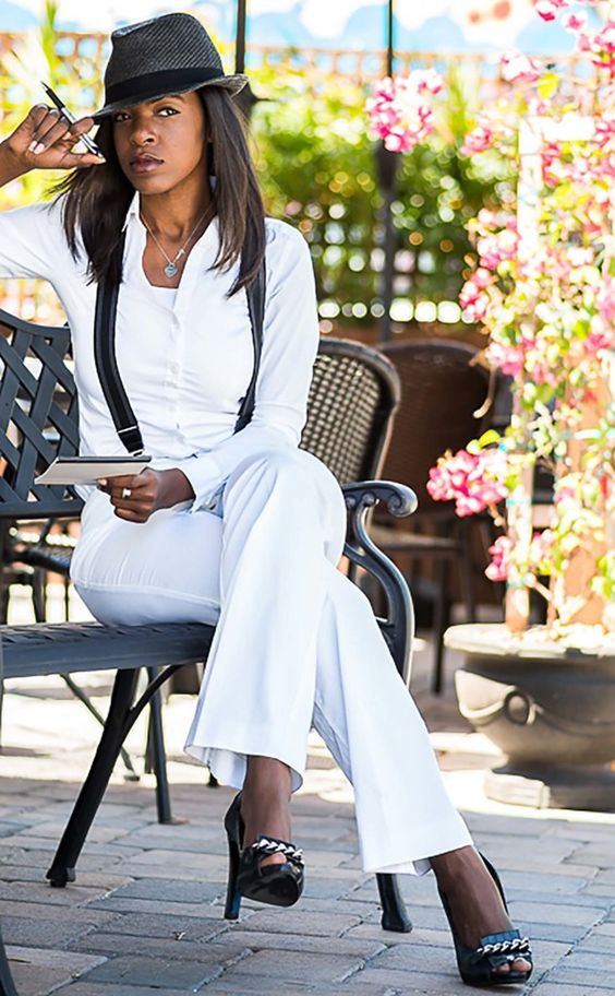 Editor in Chic. Great look for women who like menswear pieces.  Women in suspenders definitely turn heads. Get this funky black and white look with black suspenders worn over a simple white button down and slacks.