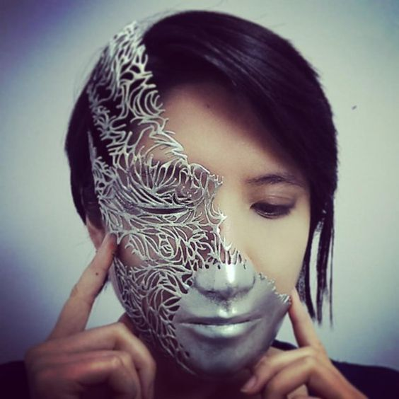 The artist, wearing one of her 3D printed masks.