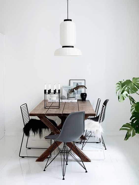 White and wood dining space in a minimalist yet cosy Finnish home.: