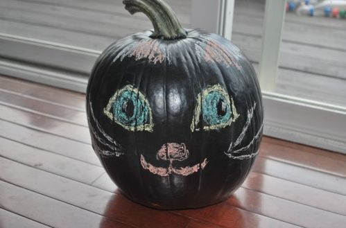 Chalkboard paint pumpkin, so kids can decorate their pumpkin as often as they want!