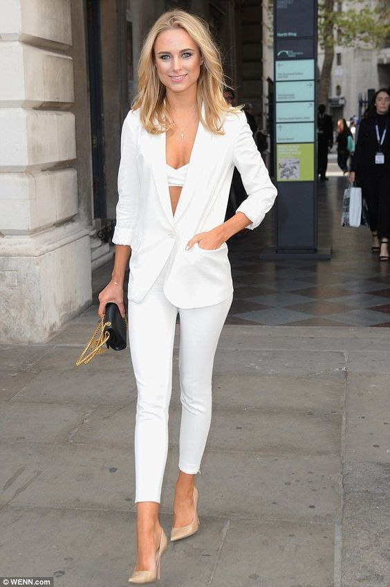 All white: Kimberley Garner flashes her bra in a white trouser suit as she attends the Top...