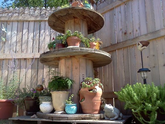 Stack those big cable stools in the garden for some interesting height displays.