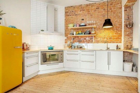 Exposed brick, timber and smeg