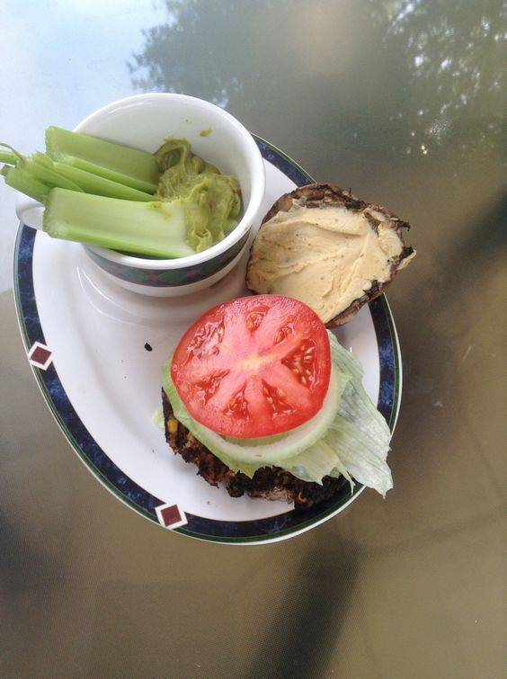 Black Bean Brown Rice Vegetarian Burger on Grilled Portabella with Mediterranean Hummus, side of Celery and Chipolte Guacamole