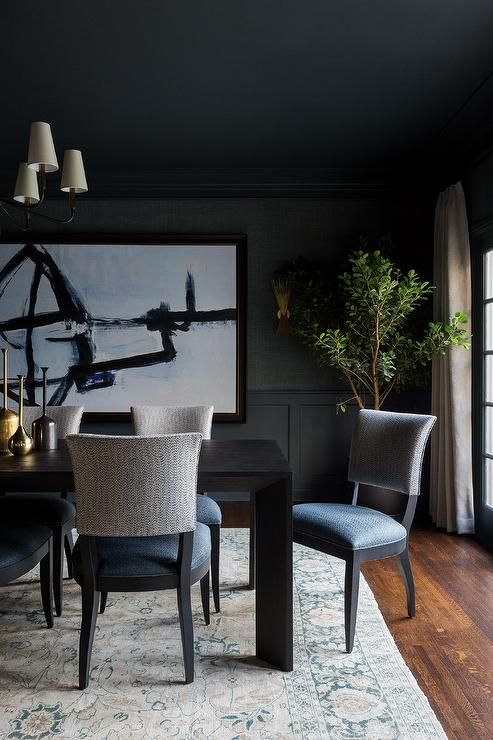 A Dark Brown Modern Dining Table Sits On A Gray And Blue Rug Surrounded By Gray And Blue Dining Chairs In 2020 Modern Dining Room Blue Dining Chair Grey Dining Tables