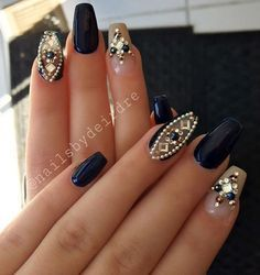 A beautiful combination of dark blue and beige with rhinestones that enrich the whole combination. Your just have to make decision about the length of the nail and shape that best stands to you.: