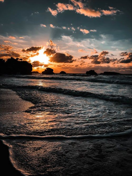 Sunlight Covering Clouds Over Sea Sunset Pictures Sunset Beach Pictures Beach Sunset Images