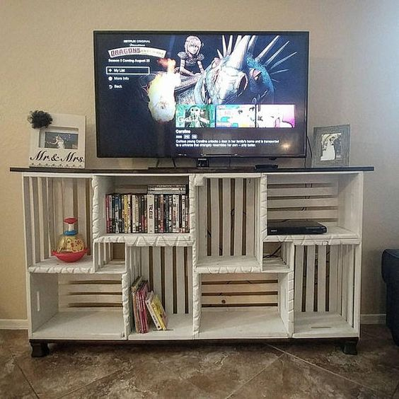 THIS ITEM IS FOR LOCAL PICKUP ONLY. Made completely from solid wood this Farmhouse inspired TV stand is a warm welcome to your living room. With a joined domestic hardwood top, Solid pallet wood crates, and a solid pine base, this TV stand is built to last. Each of the eight crates are