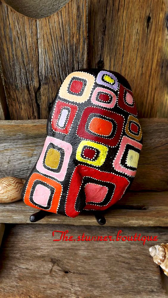Pleased to introduce you to this Aboriginal-inspired piece of art. Patterns and colours were changed according to the shape and texture of the rock. It perfectly matches a colourful, rustic interior https://www.facebook.com/pages/The-Stunner-Boutique/456809484484281