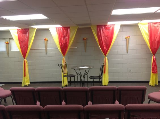 Easy impact. Use $1 tablecloths. Could go in the front on the stonewall back drop. Adds color and easy to do.
