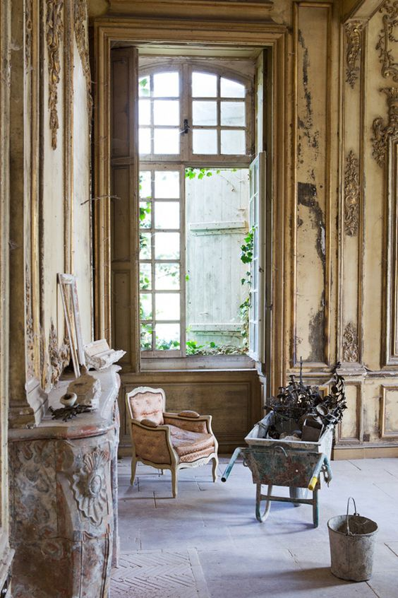Magnificent paneled walls and antique windows and fireplace in a French chateau under renovation. South of France Fixer Upper Château Gudanes. #southoffrance #frenchchateau #provence #frenchcountry #renovation