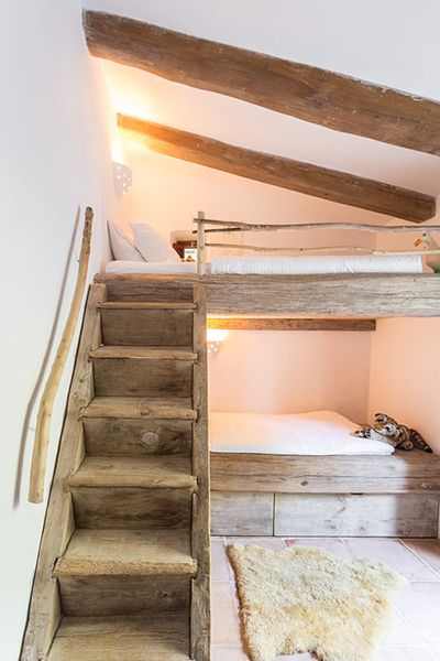 Rustic wood bunk beds in bunk room by Moredesign.es. COME SEE MORE Rustic Spanish Villa Interior Design Inspiration!