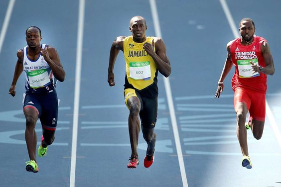 Usain Bolt, center, of Jamaica, Richard Thompson of Trinidad and Tobago and James Dasaolu of Great B... - Cameron Spencer/Getty Images