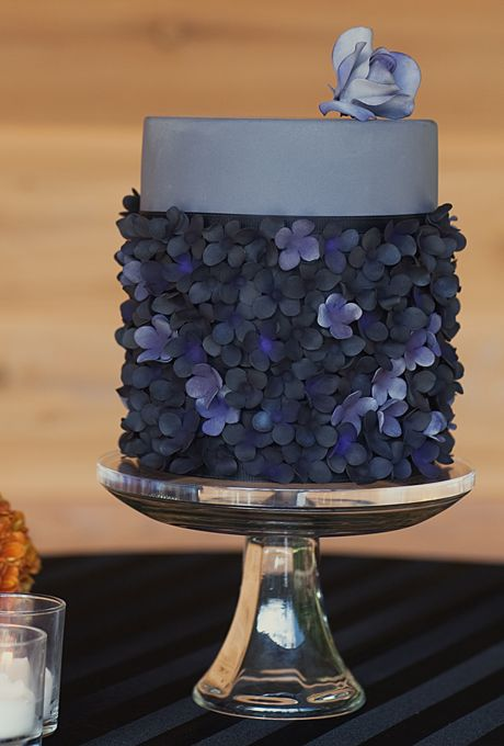 Brides.com: 22 Wedding Cakes for Dark, Modern Color Palettes. A Modern, Two-Tier Wedding Cake. The combination of tall and short tiers on this AK Cake Design confection is unexpected and striking. We love the delicate, dark flowers on the lower section and the clean, cool gray color.See more gray wedding cakes.