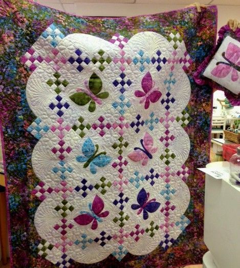 This easy, breezy quilt is fun to make as a baby quilt, wall hanging or increase the size for a bed quilt. It is pieced and butterflies are machine applique.  By Vicki Stratton.