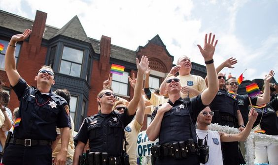 gay police pride   ... gay police association wave to crowds during the chicago gay pride