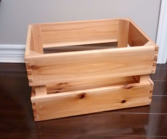 This is a simple wooden crate, made from a single leftover pine fence board and a piece of discarded wood. It is joined by a combination of wood glue, nails, and a rudimentary tongue and groove. It is surprisingly light (being pine), durable (given all the nails and glue), and smooth (due to sanding, filler, and varnish).