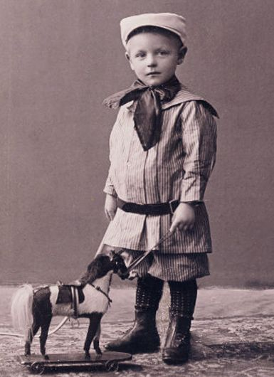 :::::::::: Antique Photograph :::::::::: Sailor boy with pull toy horse. ca. 1905: