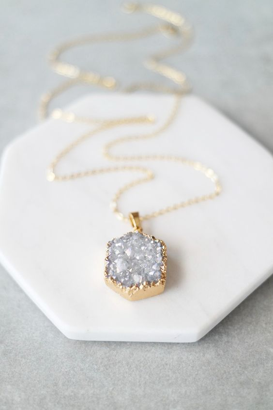 """Up your long necklace game with this Druzy hex pendant. Details: - 28"""" - Lobster clasp closure - Gold plated metal chain:"""