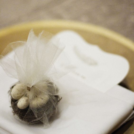 Bird nest candy favours in delicate cream tulle wait at each guest seat at this @Four Seasons Resort Jackson Hole wedding.