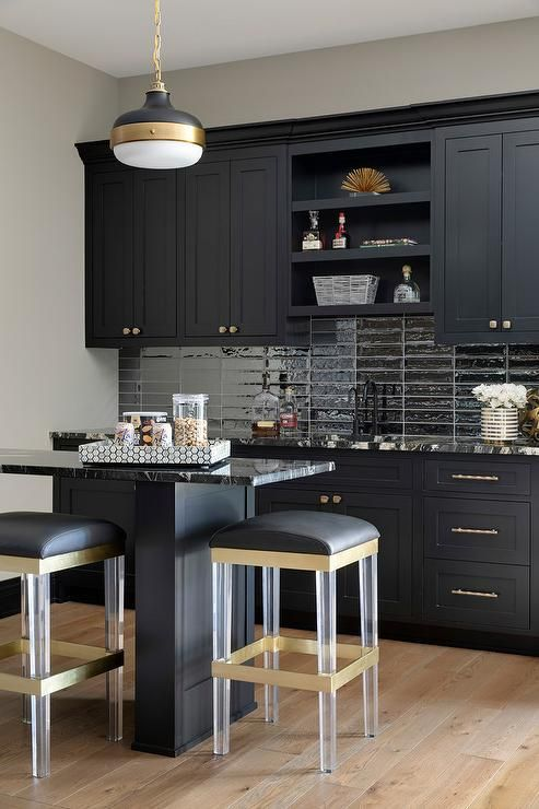 Black Wet Bar Cabinets With Brass Pulls Accented With Shiny Black