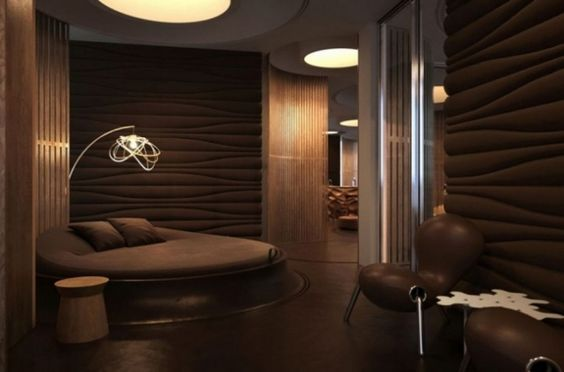 Habitación moderna con el marrón como color principal y adornos en ...