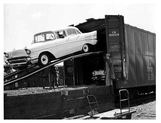 1957 Chevrolets being unloaded from a rail carrier: