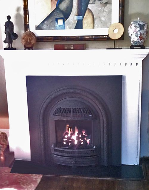 Brand new gas fireplace insert is a reproduction of an old ...