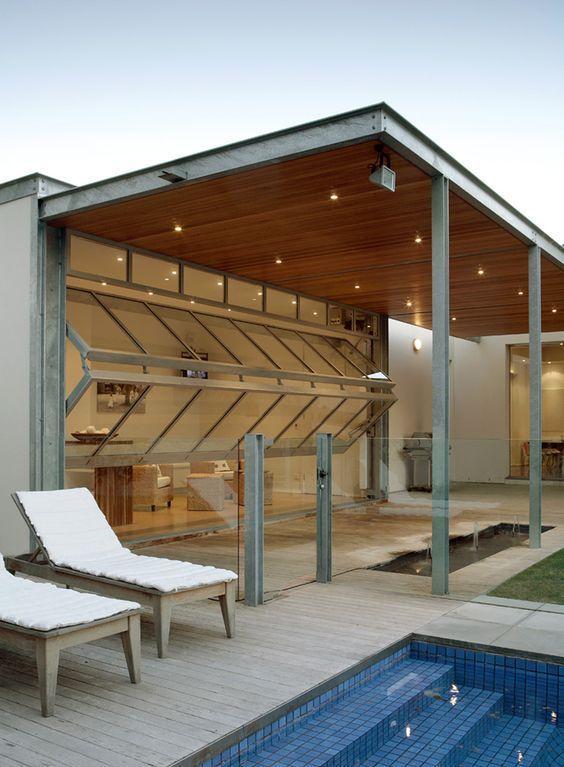 Bi Fold Garage Doors Open The Living Room To The Outdoor Spaces