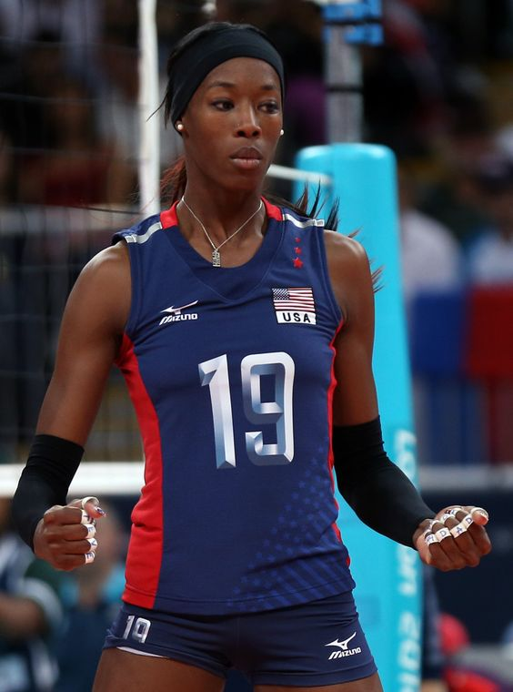 LONDON, ENGLAND - AUGUST 03: Destinee Hooker #19 of United States celebrates her shot in the third set against Serbia during Women's Volleyball on Day 7 of the London 2012 Olympic Games at Earls Court