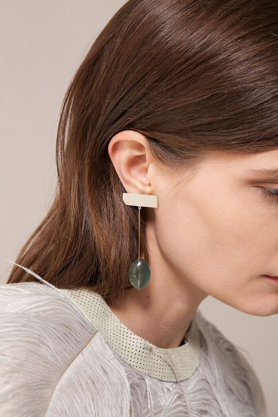 Jewelry designer and porcelain ceramicist Kathleen Whitaker's ubiquitous gold line and dot stud earrings are getting a colorful lift with a new collection that combines her signature fine, polished metal pieces with rough semi-precious stones. The two elements are juxtaposed beautifully. Some of